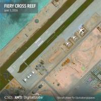 Aircraft hangars that, according to the Center for Strategic and International Studies (CSIS), have room for any fighter jet in the Chinese air force, are seen on Fiery Cross Reef in the Spratly islands, in the disputed South China Sea  June 3. | CSIS ASIA MARITIME TRANSPARENCY INITIATIV E/ DIGITALGLOBE / HANDOUT VIA REUTERS