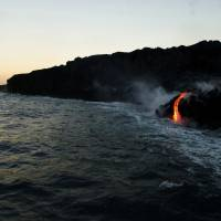 Lava from Hawaii volcano cascades into sea in vivid display