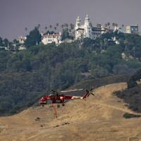 Wildfire threatens, forces closure of California's landmark Hearst Castle