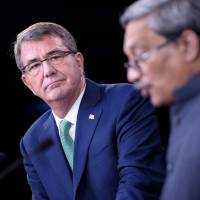 U.S. Secretary of Defense Ash Carter and Indian Defense Minister Manohar Parrikar attend a news conference at the Pentagon on Monday in Washington. | AFP-JIJI