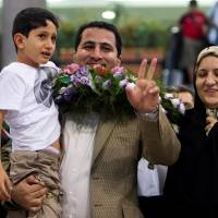 A hero or U.S. spy, Iran nuke scientist claimed innocence before hanging: mother