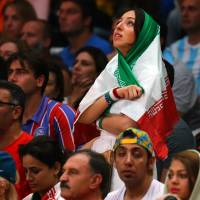 Banned from watching all-male sports events at home, Iranian woman watches volleyball game at Rio Olympics