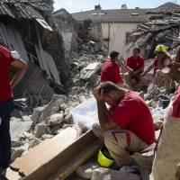 Tremors continue as Italy temblor toll hits over 200 in tourist-packed area now called 'Dante's Inferno'