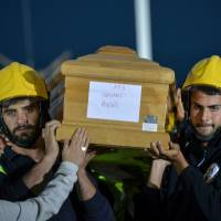 Bishop hits at shoddy quake-proofing as Italy buries dead from temblor