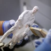 A 3-D printed figure is cleaned at a printing company in Seoul on Friday. | REUTERS