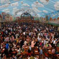 Customers fill a tent after the opening of the 182nd Oktoberfest in Munich, Germany, last September.   REUTERS