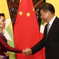 Xi meets with Suu Kyi, pledges to support Myanmar peace talks