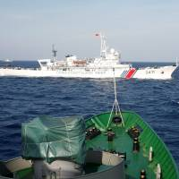 A China Coast Guard ship is seen crossing the path of a Vietnam Marine Guard vessel in the South China Sea, about 210 km off the Vietnamese coast, in 2014. | REUTERS