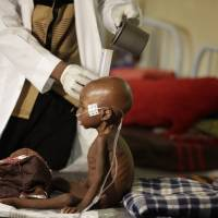 Nigeria probes theft of food aid as refugee kids starve to death
