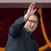 North Korean leader Kim Jong Un waves at parade participants in May at the Kim Il Sung Square in Pyongyang. South Korea's military says North Korea fired a ballistic missile on Wednesday into the sea. | AP