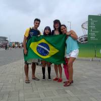 Cassio Marinho Siqueira, a 38-year-old physiotherapist from Sao Paolo, is seen with his family outside the main Barra Olympic Park with his family during the 2016 Summer Olympics in Rio de Janeiro on Sunday. | ANDREW MCKIRDY