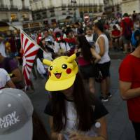The highly addictive 'Pokemon Go' game has stoked concern in Russia, where the government is wary that the game could help political opponents assemble for protests.   AP