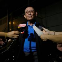 Former Philippine President Fidel Ramos speaks to journalists as he arrives at Hong Kong International Airport late Monday. | REUTERS