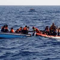 Spanish ship rescues 100 migrants off Libya, finds at least four corpses