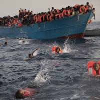 Thousands of migrants rescued in day off Libya by European vessels