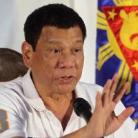 Philippine President Rodrigo Duterte addresses reporters in the city of Davao, in the south of the country, on Sunday. On Tuesday he said he wants to talk with China and will not raise the issue of disputed territory when he attends a regional summit in Laos next month. | REUTERS