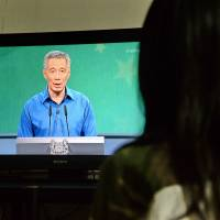Doctors rush stage as Singapore prime minister feels faint