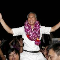 Singapore Prime Minister Lee Hsien Loong celebrates with supporters after hearing general election results at a stadium in the city-state last September. | REUTERS