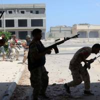 Libya loyalist forces target Islamic State holdouts near Sirte's shore