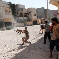 Libya loyalists suffer toll as Sirte's Islamic State holdouts put up fierce fight