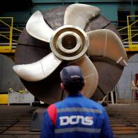 A DCNS worker looks at the propeller of a Scorpene submarine at a facility of the shipbuilder  near Nantes, France, in April. | REUTERS