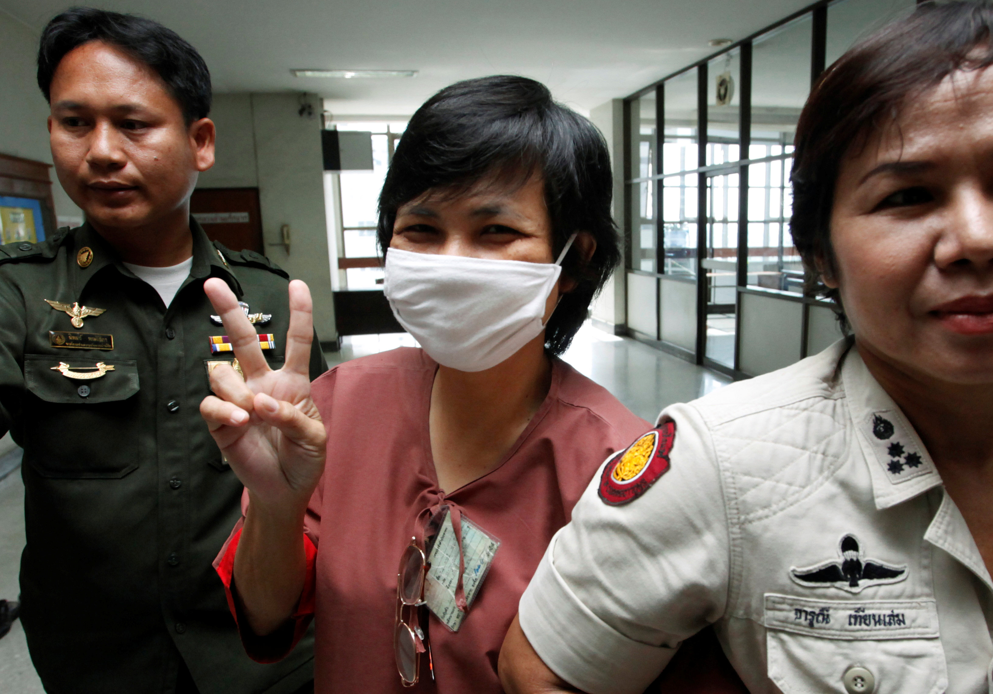 Daranee Charnchoengsilpakul, a supporter of ousted premier Thaksin Shinawatra, gestures after leaving a courtroom in Bangkok in this August 2009 file photo. | REUTERS