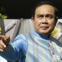 Thai Prime Minister Prayuth Chan-ocha points as he arrives for a cabinet meeting in Bangkok on Tuesday. | AP