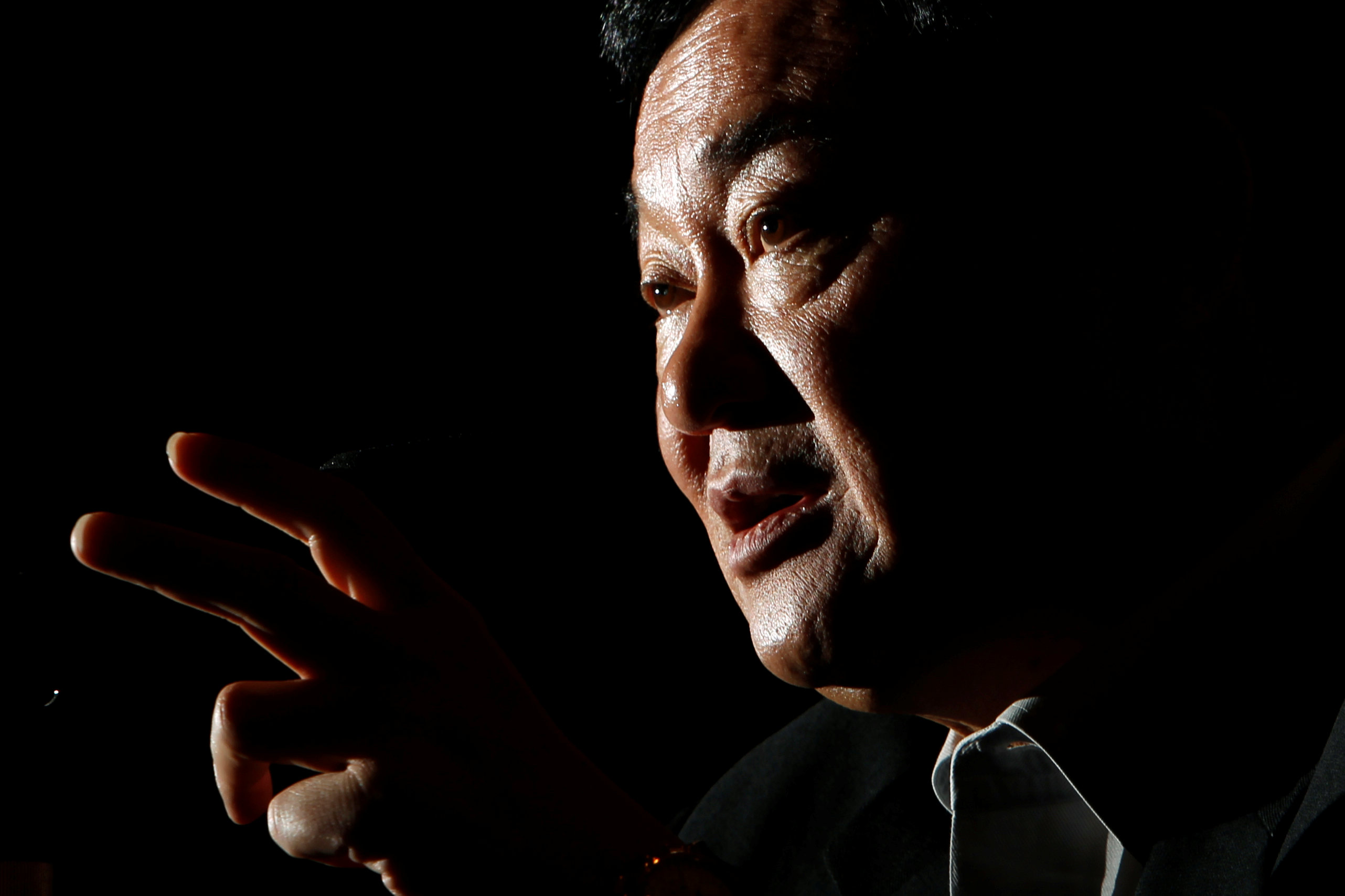 Former Thai Prime Minister Thaksin Shinawatra speaks during an interview in Tokyo in August 2011. | REUTERS