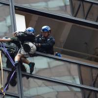 NYC cops grab man scaling Trump Tower with suction cups at 21st floor