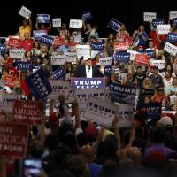 Staff revamp over, Trump campaign refocuses on Clinton, policies