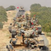 Turkey sends more tanks into Syria in operation two years in making, tells Kurds to withdraw
