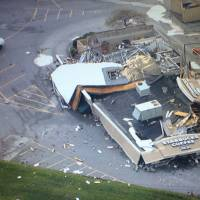 This image made from a video provided by WTHR 13 shows damage to a Starbucks after a tornado in Kokomo, Indiana, Wednesday.   NICOLE MISENCIK / WTHR 13 VIA AP