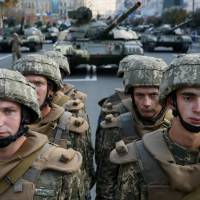 Ukrainian servicemen take part in a rehearsal for the Independence Day military parade in central Kiev on Friday.   REUTERS