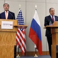 U.S. Secretary of State John Kerry and Russian Foreign Minister Sergey Lavrov attend a news conference after a meeting on the Syrian conflict in Geneva on Friday. | REUTERS