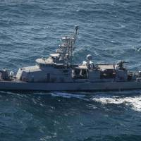 U.S. warship fires warning shots at Iranian boat racing head-on in third encounter in a day