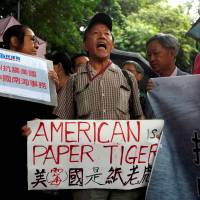 A protester from a local pro-China party chants slogans against the United States' backing of an international court ruling that denied China's claims to the South China Sea, outside U.S. Consulate in Hong Kong on July 14.   REUTERS