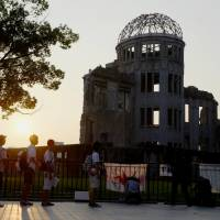 People view the Atomic Bomb Dome in the city of Hiroshima in August last year. | KYODO