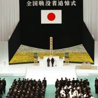 Emperor Akihito and Empress Michiko mark a minute of silence during the national commemoration of the 71st anniversary of the end of the World War II at Nippon Budokan Hall in Tokyo on Monday. | KYODO