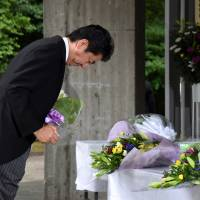 Prime Minister Shinzo Abe prays for the nation's war dead Monday at Tokyo's Chidorigafuchi National Cemetery, which houses the remains of unidentified Japanese soldiers killed overseas. | SATOKO KAWASAKI