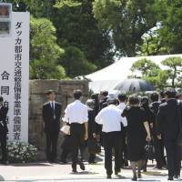 People attend a memorial service Tuesday in Tokyo for seven Japanese murdered by Islamic extremists in Dhaka last month. | KYODO