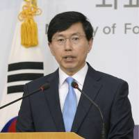 A South Korean government spokesman reacts to Japan's defense white paper at a news conference in Seoul on Tuesday.   KYODO