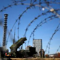 A Patriot missile unit is deployed at the Defense Ministry in Tokyo in December 2012. | REUTERS