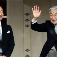 Emperor Akihito (right) waves to well-wishers while Crown Prince Naruhito looks on during their new year greetings in Tokyo on Jan. 2, 2015. The Emperor on Monday said he is worried his weakening health may make it hard to fulfill his duties. | AFP-JIJI