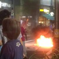 A fire breaks out after an apparent Molotov cocktail was thrown toward a samba street festival in Tokyo's Suginami Ward on Sunday. | KYODO