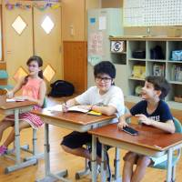 Children learn Japanese at a special school in Iga, Mie Prefecture, in July. The school helps them adopt to culture in Japan.   KYODO