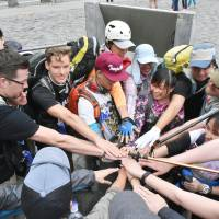 Tourists get ready to climb to the summit of Mount Fuji at its fifth station on July 20. | KYODO