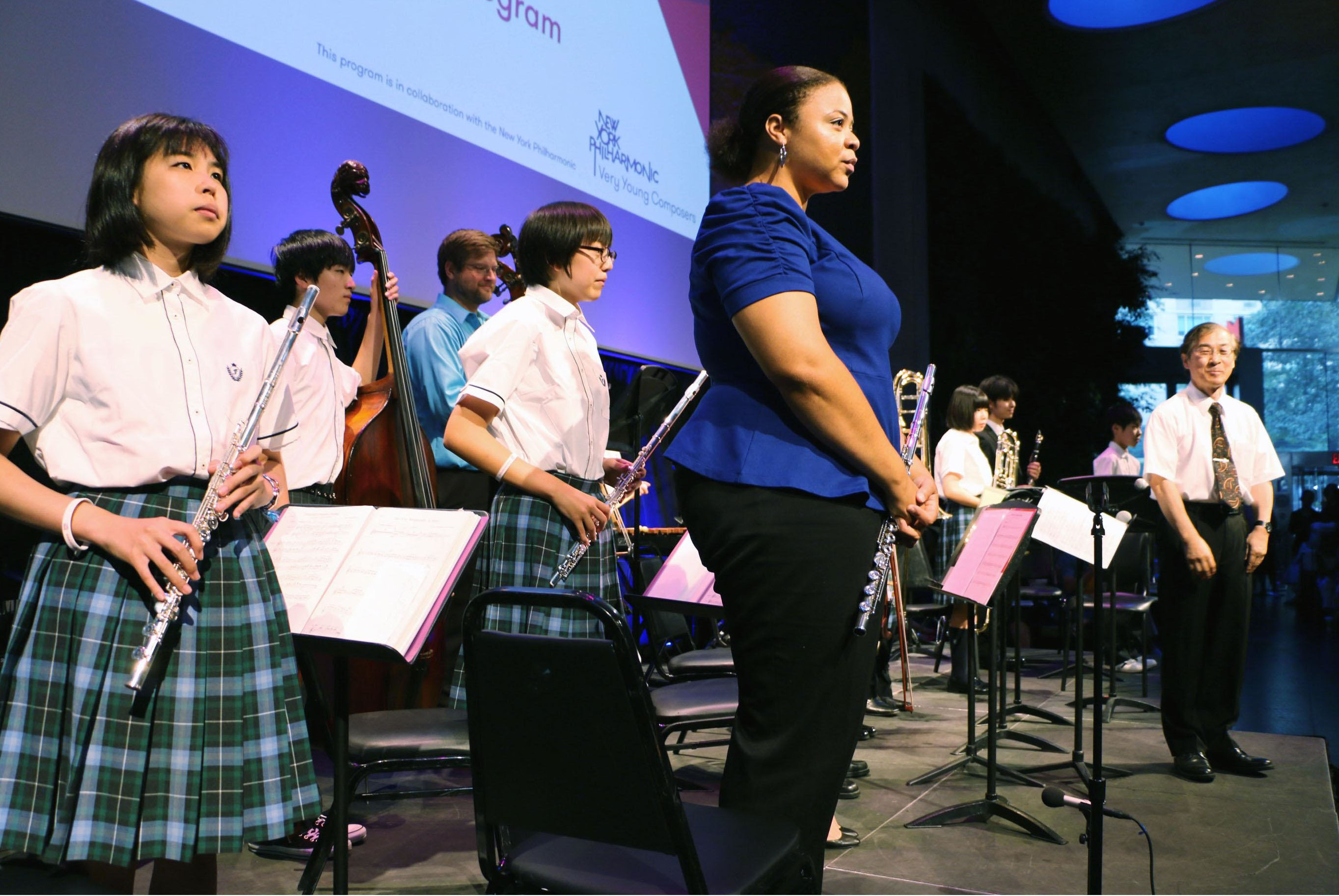 Music students from Fukushima Prefecture perform with members of the New York Philharmonic in New York on Saturday. | KYODO