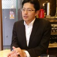 Akinori Saito, president of call girl chain Okaasan, says his company takes rigorous measures to prevent employees from sexual disease and stalkers, in an interview in Tokyo on July 23. | TOMOHIRO OSAKI