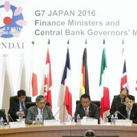 Finance Minister Taro Aso (center) addresses the Group of Seven finance chiefs at their meeting in Sendai on May 20. How to cooperate on halting cross-border transactions related to terrorism was one of the issues discussed there. | KYODO