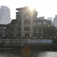 The sun rises behind the Atomic Bomb Dome in Hiroshima on Saturday, the 71st anniversary of the U.S. atomic bombing of the city.   KYODO